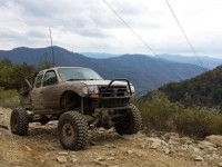 The 2000 Toyota Tacoma Solid Axle truck looks right at home on the dirt.