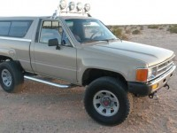 This clean 1986 Toyota Truck has Rancho shocks and a nice collection of lights. It also looks really clean for its age.