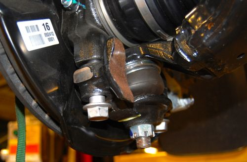"ToyTec 3"" Lift Kit Install Step 9: Reattach lower control arm & reinsert lower shock bolt"