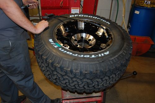 How to Remove and Reinstall TPMS Sensors: Set the tires on the new wheel